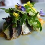 oast sardine tartlet on basil flavoured tomatoe and smoked Idiazabal ( cheese) salad